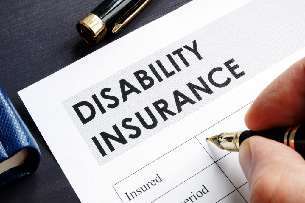 Man is filling in Disability insurance form.