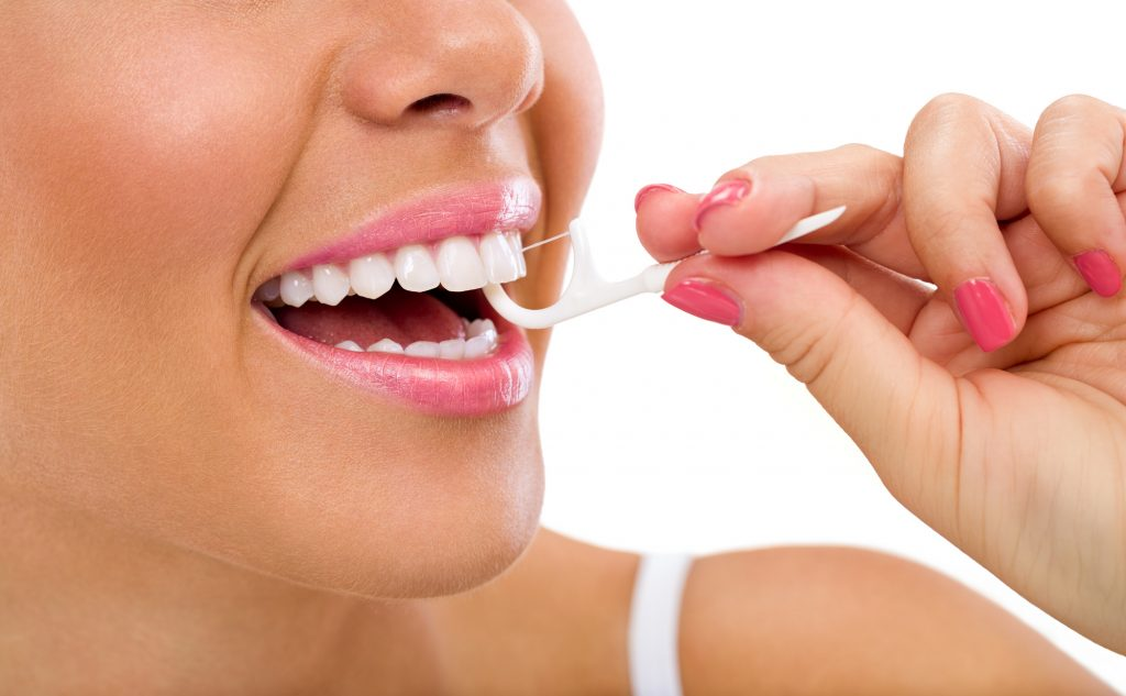 woman cleaning flossing